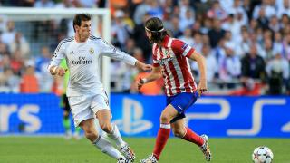 Gareth Bale y Filipe Luis durante el partido