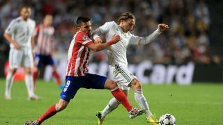 David Villa y Luka Modrić durante el encuentro