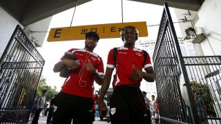 Manucho y Bebé, a su llegada al Wutaishan Stadium