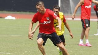 Fernando Torres y Koke, durante la sesión