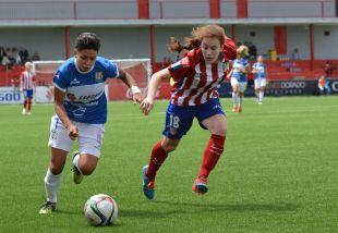 Bea Beltrán y Maria José pugnan por un balón.